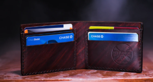 2019-10-27 20_16_46-brown leather bifold wallet on table photo – Free Wallet Image on Unsplash