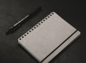 2019-12-06 08_52_38-black click pen beside notebook photo – Free Grey Image on Unsplash