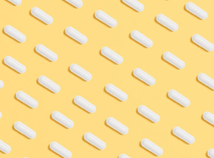 2020-06-05 21_11_06-White Capsules on Yellow Background · Free Stock Photo