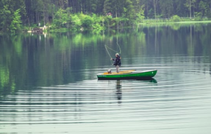 2017-03-11 19_04_28-Person on Green Boat Fishing on Body of Water · Free Stock Photo