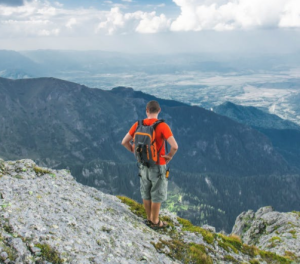 2017-07-02 15_59_43-Gray and Orange Backpack Worn by Man at Mountain · Free Stock Photo