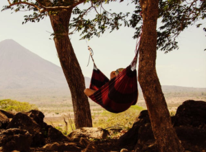 2017-12-21 19_31_08-Person Lying on Black and Red Hammock Beside Mountain Under White Cloudy Sky dur
